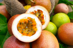Half cut passion fruit. Half cut fresh passion fruit with golden yellow pulp Stock Photo