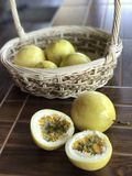 Half-cut passion fruits & x28;Passiflora edulis& x29; in and out of basket Royalty Free Stock Photos