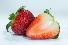 Half cut red strawberry fruits , ripe berry stock photo