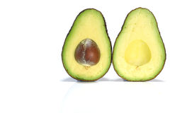 Half cut standing avocado and copy space Royalty Free Stock Image