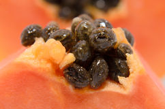 Half cut and whole papaya fruits Royalty Free Stock Images