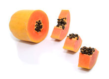 Half cut and whole papaya fruits Stock Photography