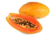 Half cut and whole papaya fruits on white background Royalty Free Stock Image