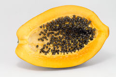 Half cutted of bright yellow sweet mellow papaya isolated on white, in Peru.  Stock Images