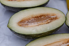 Half cutted melons from a market Royalty Free Stock Image