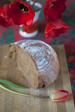 Half dark bread and tulips Royalty Free Stock Images