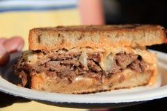 Half of a delicious Rueben sandwich Stock Photos