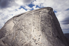 Half Dome Cables in Yosemite. Hikers climbing the cables in Yosemite national park. The slick limestone with a steep drop is a challenging hike Royalty Free Stock Photography