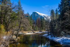 Half dome mountain in Yosemite Park. Half dome mountain peak towering over the trees bellow at Yosemite National Park in California, USA Royalty Free Stock Photo