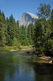 Half-Dome Peak and River 2 in Yosemite. Half-Dome Peak Dominates the park and river in Yosemite Stock Images