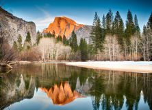 Half Dome Reflected in Merced at Sunset Stock Photo