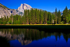 Half Dome with reflection in Merced river royalty free stock images