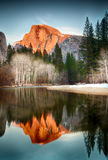 Half Dome Reflection at Sunset. View of half dome at sunset reflected in the Merced River Royalty Free Stock Images