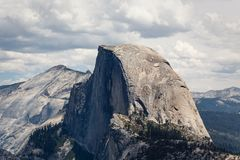Half Dome rises above rest of mountains in beautiful landscape in Yosemite National Park Royalty Free Stock Photo
