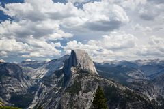 Half Dome, a very high peak, rises above rest of mountains in beautiful mountain landscape in Yosemite National Park Royalty Free Stock Image