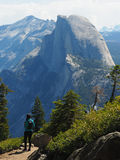 Half Dome from Sentinel Dome Trail. Female hiker viewing the north face of Half Dome in Yosemite national park royalty free stock photo