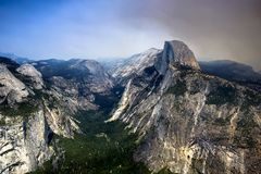 The half dome on a smoky day. Wildfire smoke overwhelming yosemite valley and the half dome Royalty Free Stock Photo