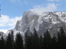 Half Dome. A snow capped Half Dome in Yosemite National Park Stock Image