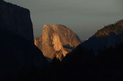 Half Dome at Sunset. Half Dome glows in the fading sunlight at sunset at Yosemite National Park Royalty Free Stock Photography