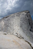Half Dome. View of the cables from the sub-dome. Yosemite National Park. Cloudy stormy sky above royalty free stock photo