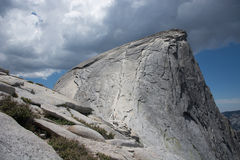 Half Dome. View of the cables from the sub-dome. Yosemite National Park. Half Dome Cables, from the sub-dome. Mid-afternoon as storm clouds gather. Yosemite royalty free stock image