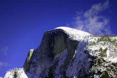 Half Dome in Winter. A shot of Snow-capped Half Dome in Yosemite National Park in the Winter Stock Photos