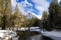 Half Dome In Winter. A view of Half Dome in the winter with the Merced River Royalty Free Stock Image