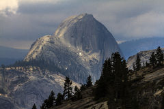 Half Dome Yosemite. This image is of Half Dome in Yosemite National Park.  This photograph was taken in the spring from Olmsted Point on a cloudy day Stock Photos