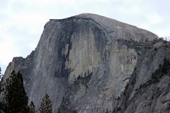Half Dome, Yosemite National Park, California. Seen from Curry Village Parking Lot,  dome shaped granite rock with vertically cut front rising 1444 m above Stock Photos