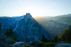 Half Dome in Yosemite National Park getting lit by sunrise light Royalty Free Stock Image