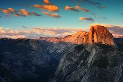 Half Dome of Yosemite during sunset. Half Dome rock formation during sunset with twilight sky in Yosemite National Park. Beautiful scenic view from Glacier Point Stock Photo