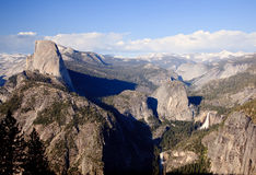 Half Dome in Yosemite Valley. Half Dome with the Sierra Mountains and waterfalls in the distance royalty free stock image