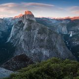 Half Dome and Yosemite Valley in Yosemite National Park during colorful sunset with trees and rocks. California, USA. Sunny day in the most popular viewpoint in stock photos