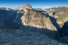 Half Dome and Yosemite Valley in Yosemite National Park during colorful sunset with trees and rocks. California, USA. Sunny day in the most popular viewpoint in stock images