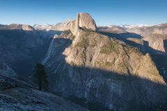 Half Dome and Yosemite Valley in Yosemite National Park during colorful sunset with trees and rocks. California, USA. Sunny day in the most popular viewpoint in stock photography