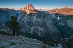 Half Dome and Yosemite Valley in Yosemite National Park during colorful sunset with trees and rocks. California, USA. Sunny day in the most popular viewpoint in royalty free stock images