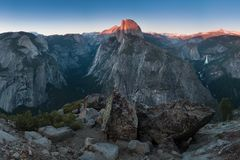 Half Dome and Yosemite Valley in Yosemite National Park during colorful sunset with trees and rocks. California, USA. Sunny day in the most popular viewpoint in royalty free stock photo