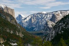Half Dome in Yosemite in winter. A snowy view of Half Dome at the Yosemite National Park in winter time. Snow on the mountains and in the trees Royalty Free Stock Photography