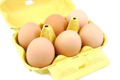 Half a dozen eggs in a yellow carton viewed from Royalty Free Stock Photos