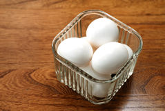 Half Dozen Fresh Eggs. Six dairy fresh eggs in a glass refrigerator dish Stock Image