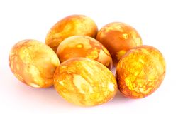 Half dozen of golden marbled Easter eggs Stock Images