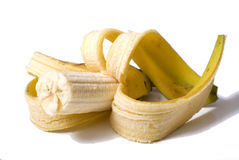 Half-eaten banana. Pealed banana with half eaten, half still left Royalty Free Stock Images