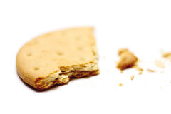 Half-eaten biscuit. Close-up of a half eaten biscuit on a white background Stock Photography
