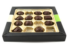 Half eaten box of chocolates over white Stock Image