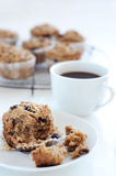 Half eaten bran muffin Stock Photos