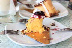 Half eaten cake. On a plate Royalty Free Stock Images