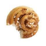 Half-eaten cinnamon bun Stock Photo