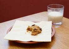Half-eaten cookie with a half drunk glass of milk Stock Photography