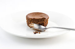 Half eaten delicious chocolate cake muffin with dirty spoon Royalty Free Stock Images