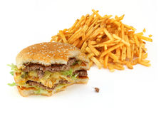 Half-eaten hamburger and french fries. Against white background Stock Photography